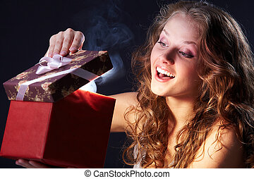 Wonderful gift - Image of happy girl looking into gift box ...