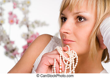 wonderful girl with beads - beautiful girl with flowers on a...