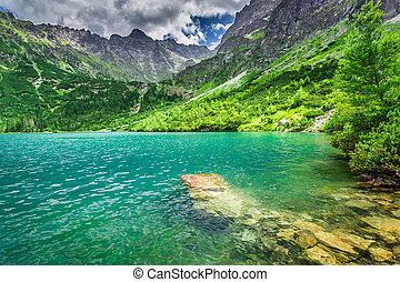 Wonderful lake in the middle of the mountains at summer