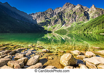 Wonderful lake in the mountains at sunrise, Poland, Europe