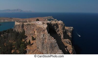 wonderful old castle on brown hill top at endless blue sea -...