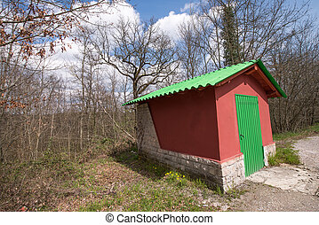 Wonderful Red and Green small house at the side of a Campaign Ro
