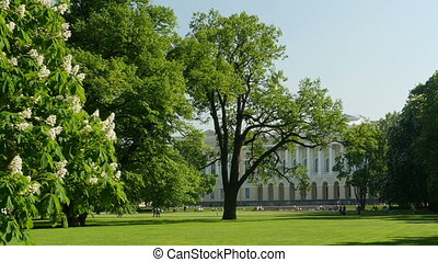 Wonderful royal park - people walk and relax in the shade of...