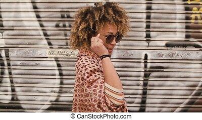 Wonderful smiling ethinic woman on street - Portrait of ...