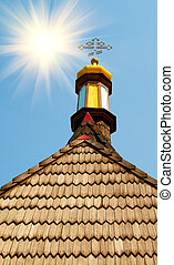 Wonderful sunrise and old roof of church.