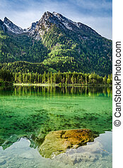Wonderful sunrise at Hintersee lake in Alps, Germany