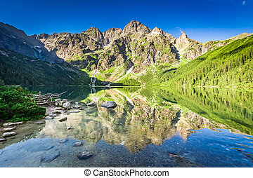 Wonderful sunrise at lake in the Tatra Mountains in summer
