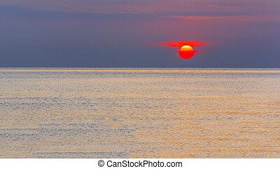 Wonderful sunrise over a calm sea