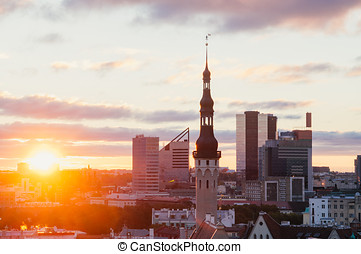 Wonderful sunrise over townhall and modern buildings, Tallinn