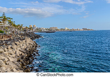 Wonderful Views Of The Bay Playa De Las Americas Full Of High Rise Hotels Buildings. April 11, 2019. Santa Cruz De Tenerife Spain Africa. Travel Tourism Street Photography.