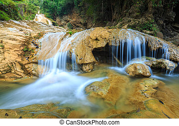 wonderful waterfall with colorful tree in thailand