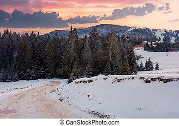 wonderful winter countryside in mountains at dusk. road...