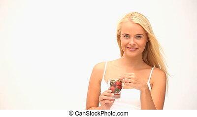 Wonderful woman eating fruit