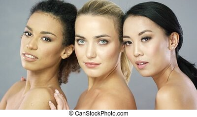 Wonderful women posing in studio - Three pretty young women...