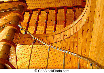 Wonderful wooden ceiling and spiral staircase in the modern hous