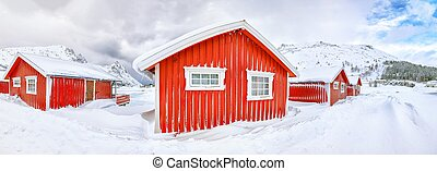 Wonderfull winter scenery with traditional Norwegian red wooden houses on the shore of Rolvsfjord on Vestvagoy island