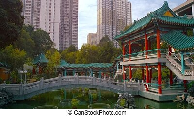 Wong Tai Sin Temple, with its Graceful Bridge over an Ornate Pond