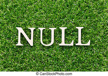 Wood alphabet in word null on artificial green grass background
