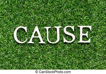 Wood alphabet letter in word cause on artificial green grass background