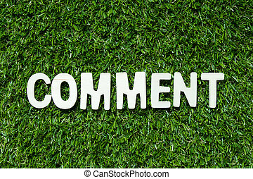 Wood alphabet letter in word comment on artificial green grass background