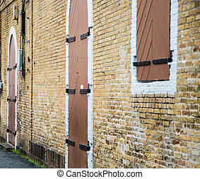 Wood and Iron Windows and Doors in brick Wall