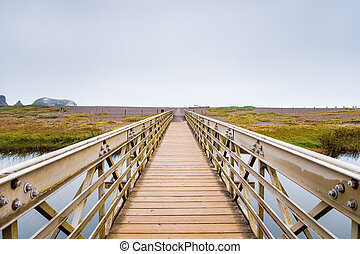 Wood and metal bridge crossing the Rodeo Lagoon towards ...