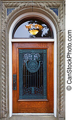 Wood and ornate grill door