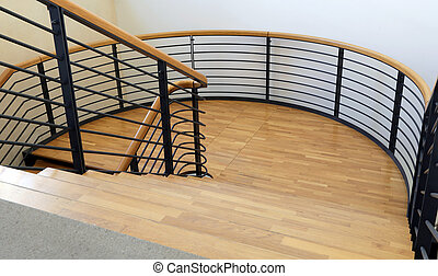 wood and steel stairway in a modern building with parquet