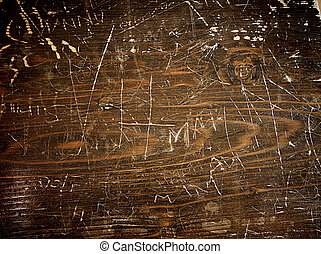 wood background dark wooden table with graffiti