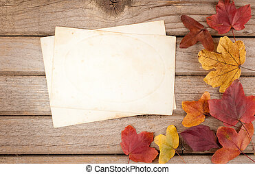 wood background with autumn leaves