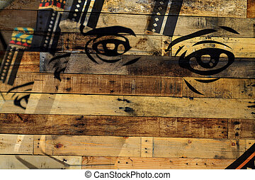 wood background with face