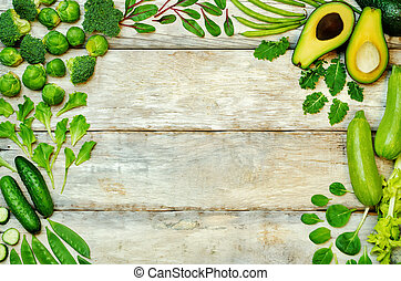 Wood background with green vegetables. toning. selective...