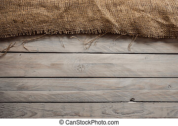 Wood background with hessian textile