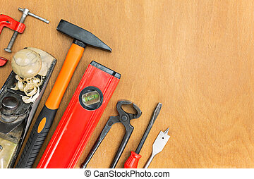 Wood background with various tools