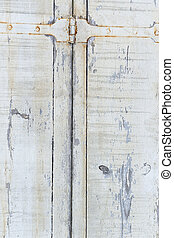 Wood backgrounds Old door from darkened boards with archaic iron plates