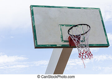 Wood Basketball hoop on blue sky and cloud background