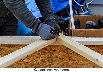 wood battens of modern building Closeup of a carpenter's hands