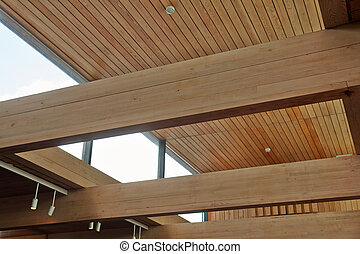 Massive wood beams inside a modern design building office