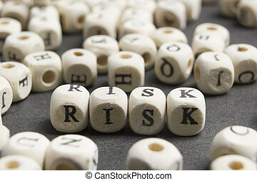 Wood Blocks with the text Risk. Wooden Abc