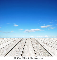 Wood board on blue sky background