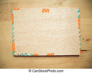 Wood board with fancy decore border on wooden background