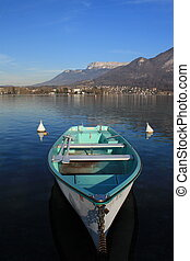 Wood boat on the Annecy lake, France