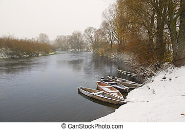 Wood boats on winter river