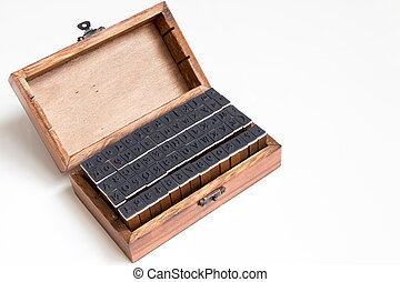 Wood box contain english alphabet and number rubber stamp on white background