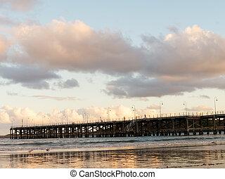Wood bridge extending to the ocean
