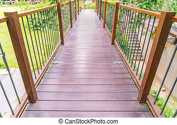 Wood bridge in the garden .