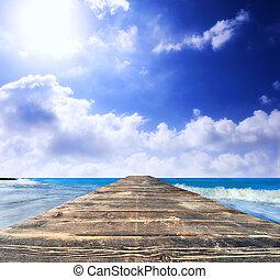 Wood bridge in the ocean
