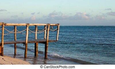 Wood bridge on the beach near ocean