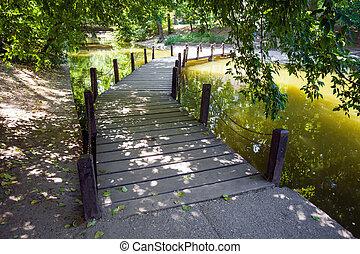 Wood bridge over the defense lake surrounding Vajdahunyad Castle