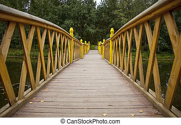 Wood bridge over water to forest perspective view